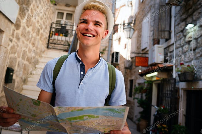 Young happy man traveler enjoying vacation, tourism and having fun