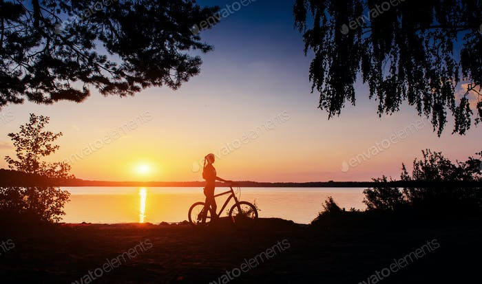 Woman on bicycle in the west