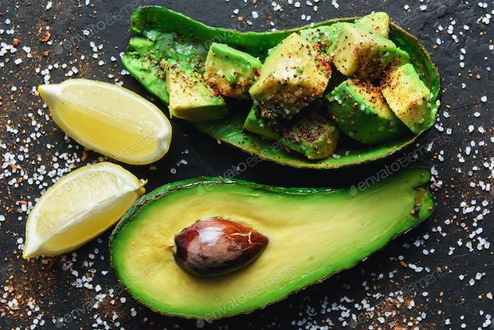 Fresh avocado fruit on a wooden board