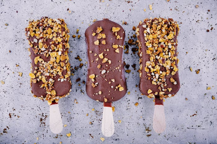 chocolate ice cream popsicle on rustic background