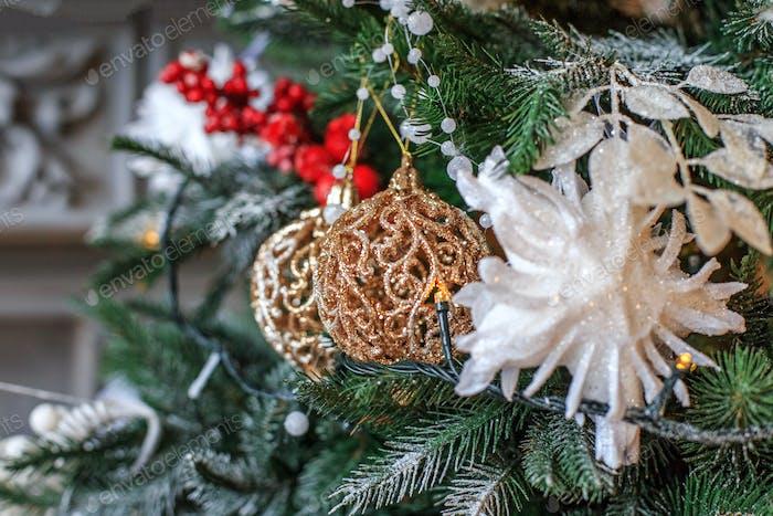 Christmas decor on tree. Christmas tree branch with ball. Concep