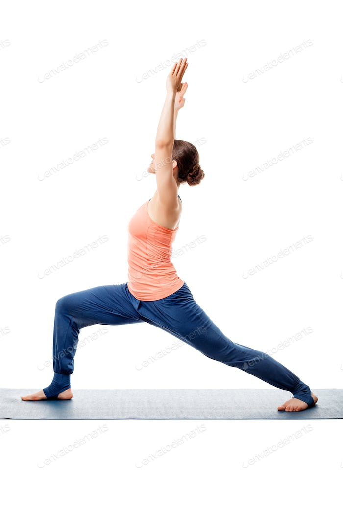Sporty woman practices yoga asana