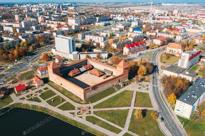 Lida, Belarus. Aerial Bird's-eye View Of Cityscape Skyline. Lida Castle In Sunny Autumn Day