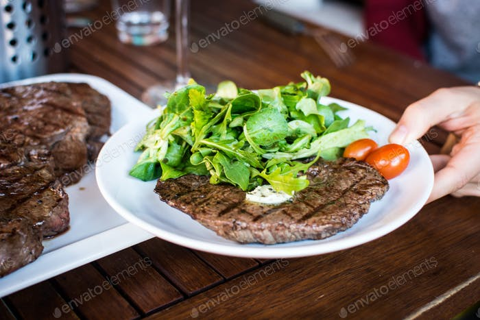 Grilled beef steak with side salad
