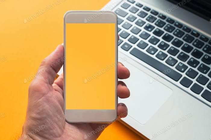 Smart phone in hand with mock up screen