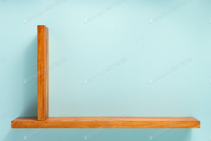 woden shelf at abstract wall background