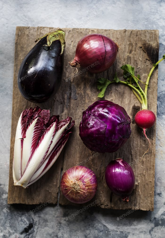 Aerial view of purple vegetable group collection on wooden table