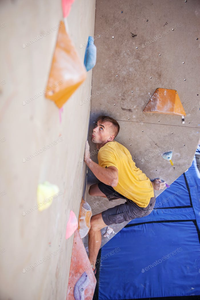 Male climber on artificial climbing wall