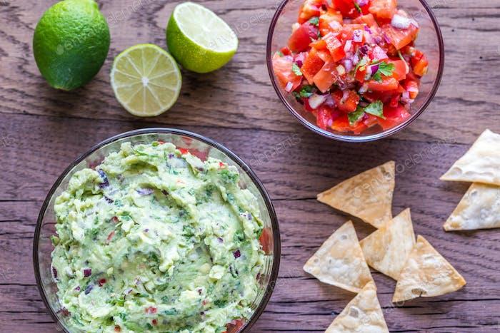 Bowls of guacamole and salsa