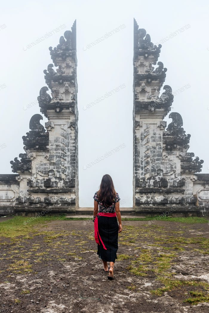 Woman in front of Traditional Balinese gate, Indonesia
