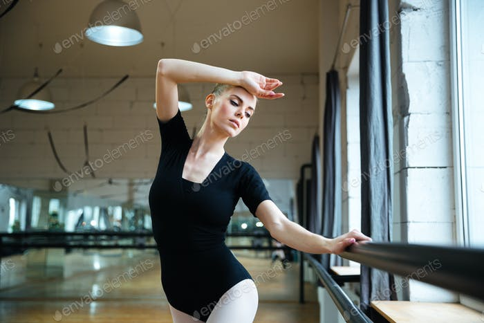 Woman practicing in ballet class