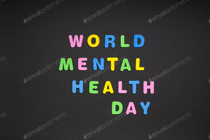 World Mental Health Day writing on black paper