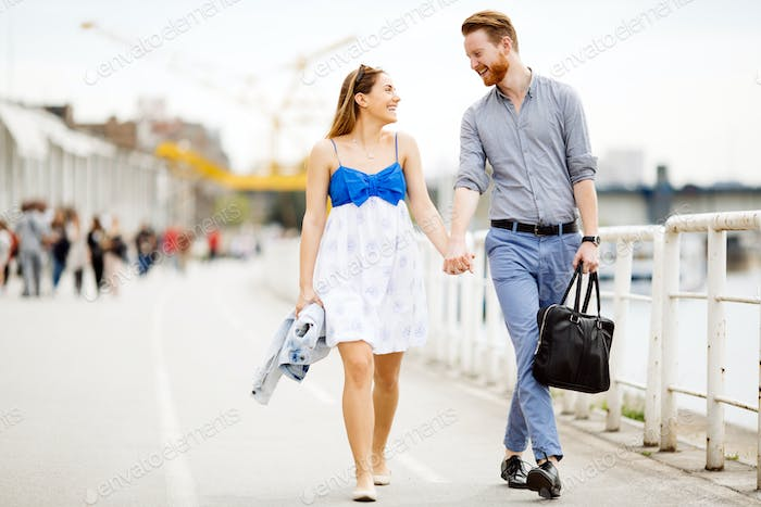 Happy couple walking outdoors