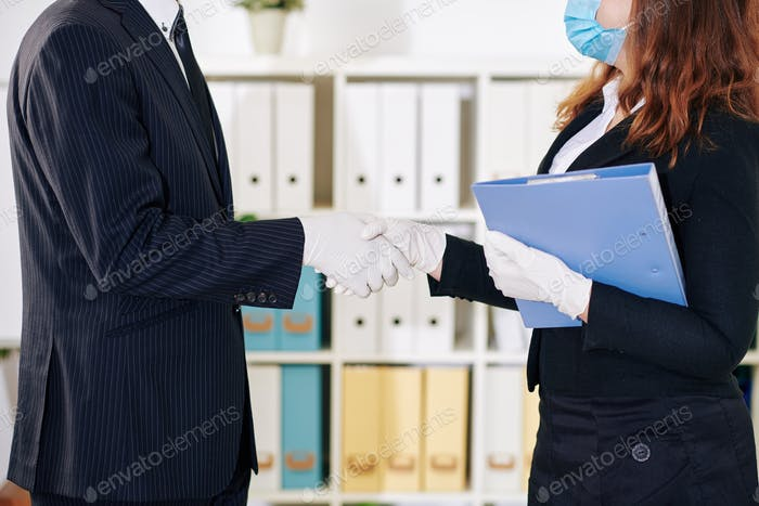 Shaking hands in rubber gloves