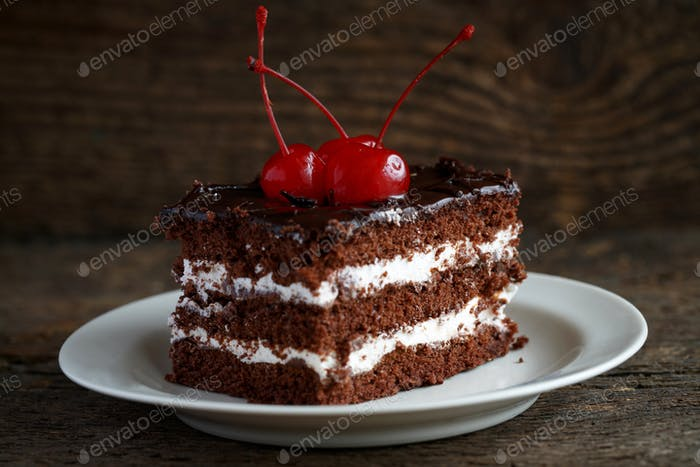 Delicious chocolate cakes with cherry close-up