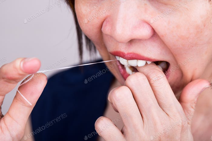 Series of Asian woman flossing teeth with oral floss