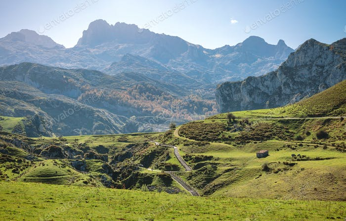 Landscape with path between mountains