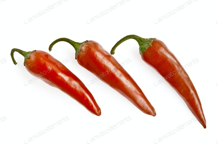 Three red hot pepper