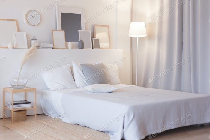 modern bedroom with floor lamp and decorations
