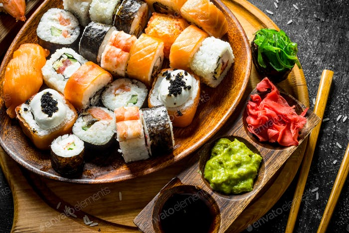 Assorted different types of Japanese sushi and rolls.