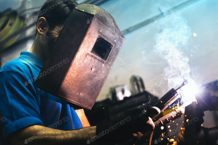 Professional Mechanic welding.