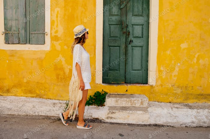 Woman goes along street