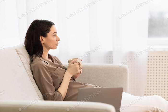 Thumbnail for Young woman drinking coffee looking at window