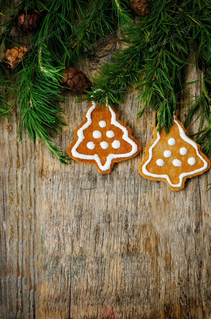 Christmas tree background with Christmas tree and gingerbread sh
