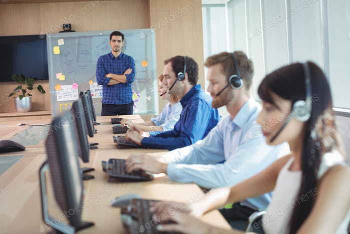 Manager with business team working at call center