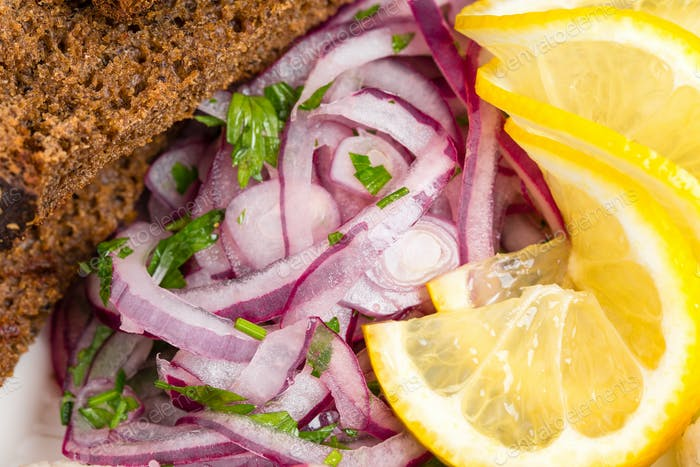 Grilled bread and marinated red onion.