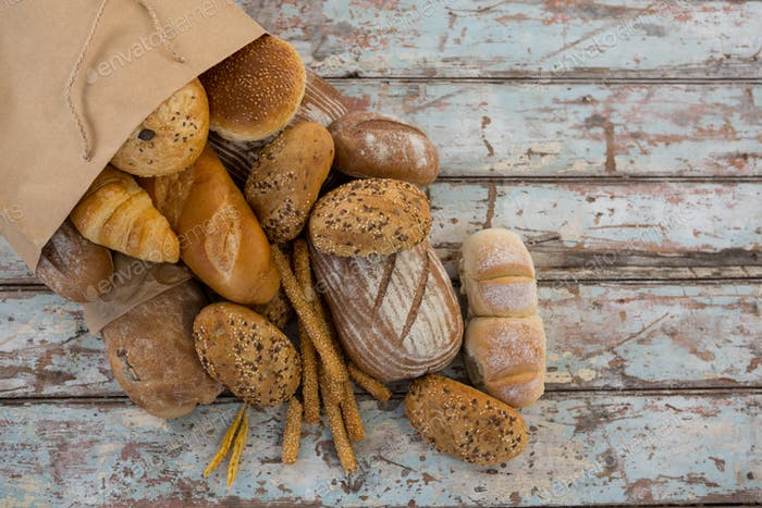 Variety of bread coming out of paper bag