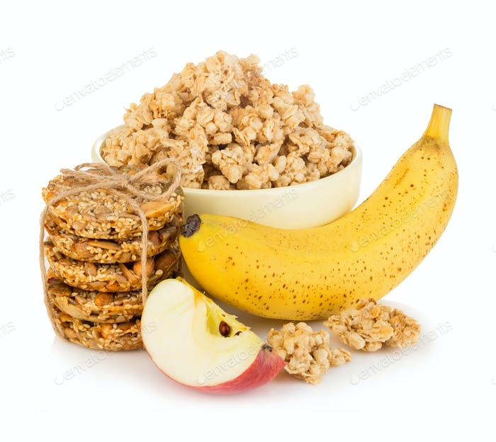 Breakfast cereal with banana and apple close-up isolated on white background. Healthy food.