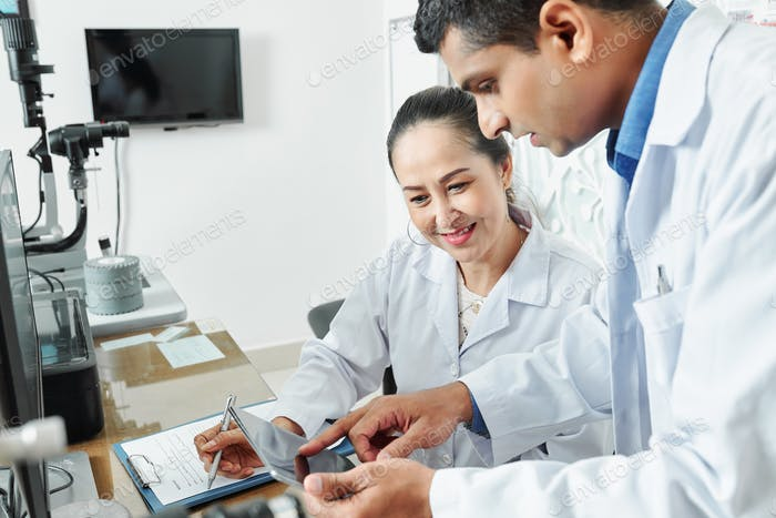 Two doctors working with tablet pc
