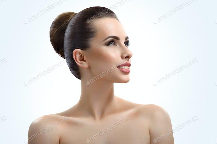 Beautiful young woman posing in studio