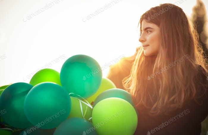 Cute girl with air balloons