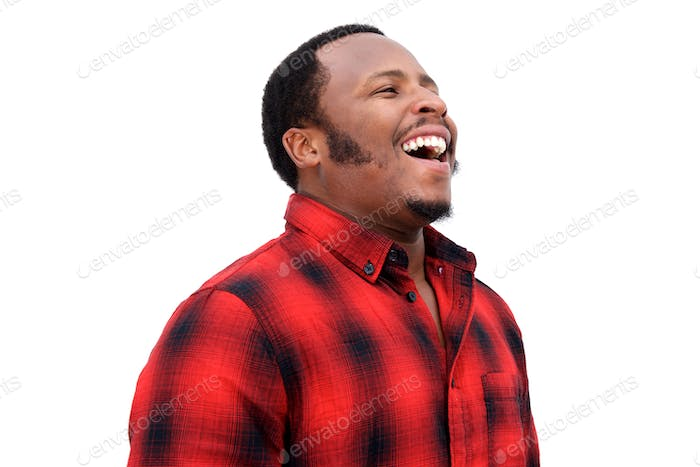 Close up portrait of young african american man laughing