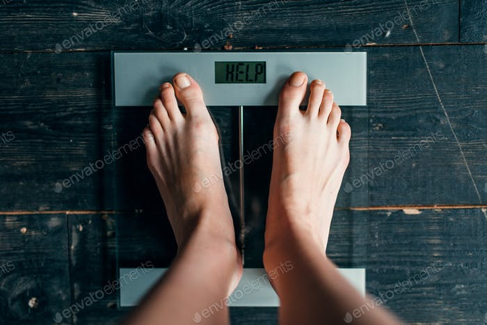 Female feet on the scales with inscription help