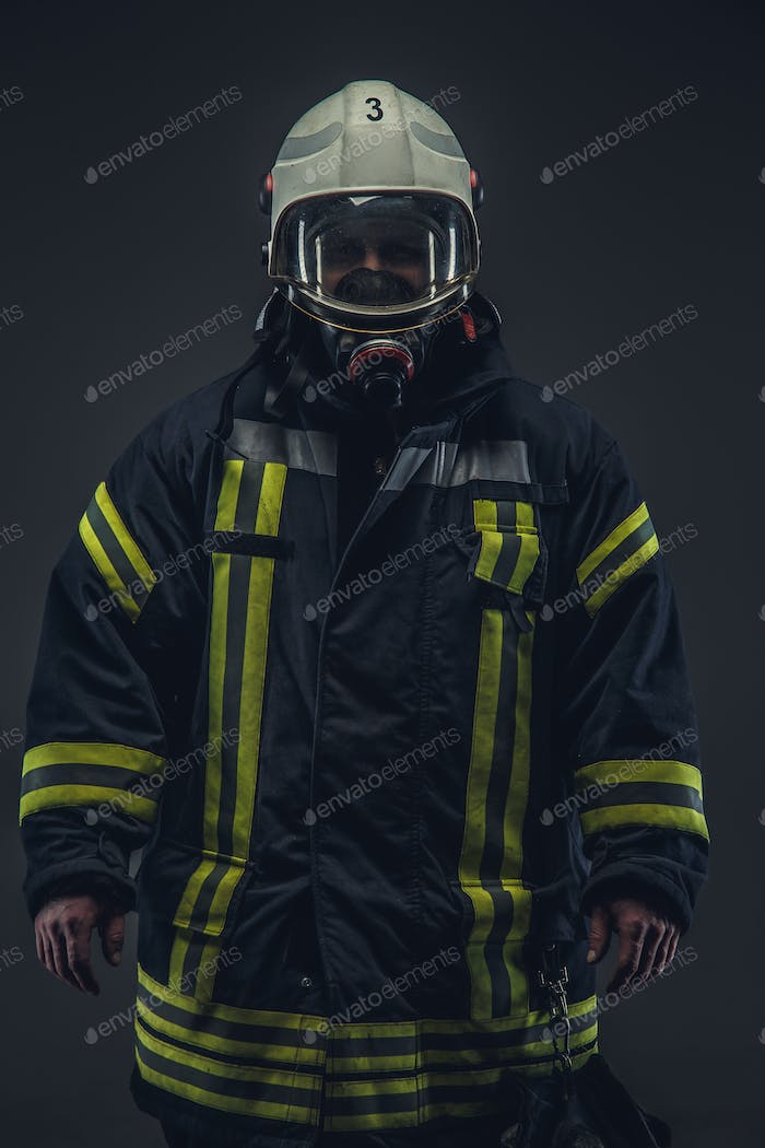 Firefighter in uniform and oxygen mask.