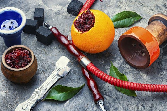 Oriental hookah with orange flavor.