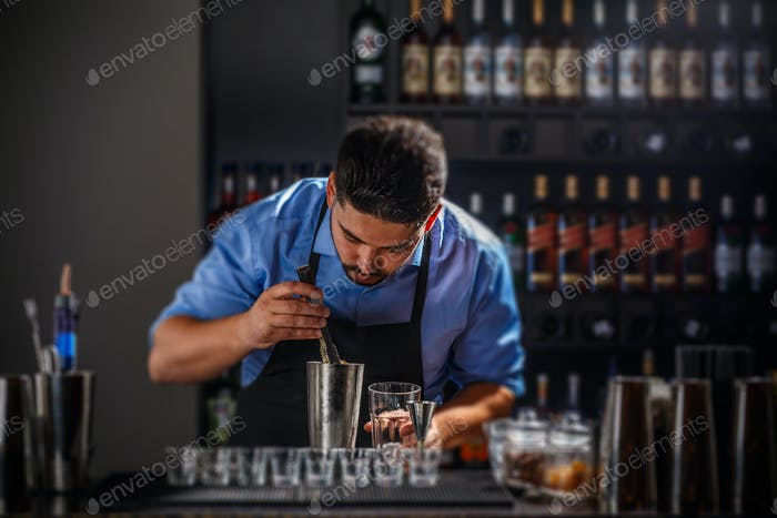 Bartender preparing an alcoholic beverage