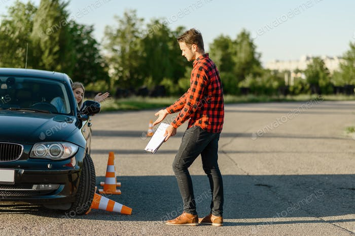Female student knocks down traffic cone