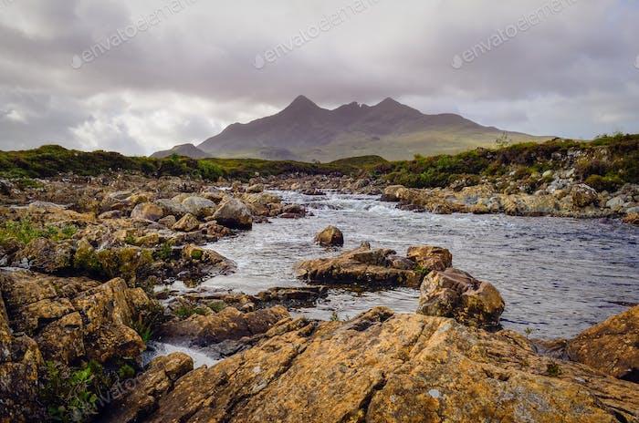Landscape of Cuillin hills and river, Scottish highlands