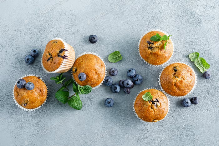 Blueberry banana muffins with fresh berries