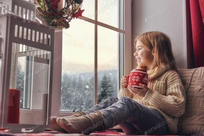 girl sitting by window