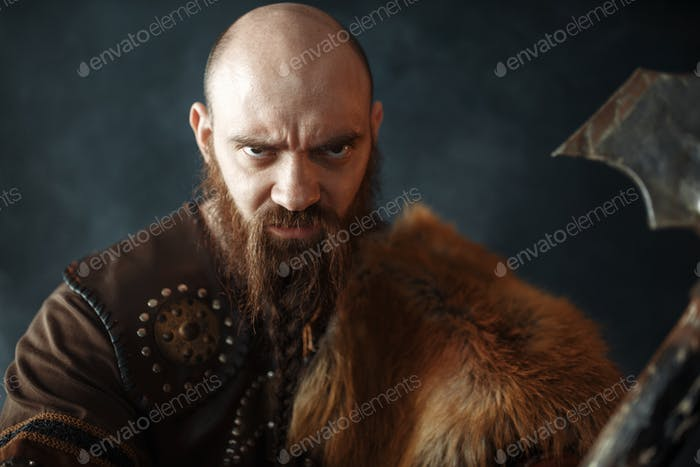 Portrait of viking with axe, martial spirit