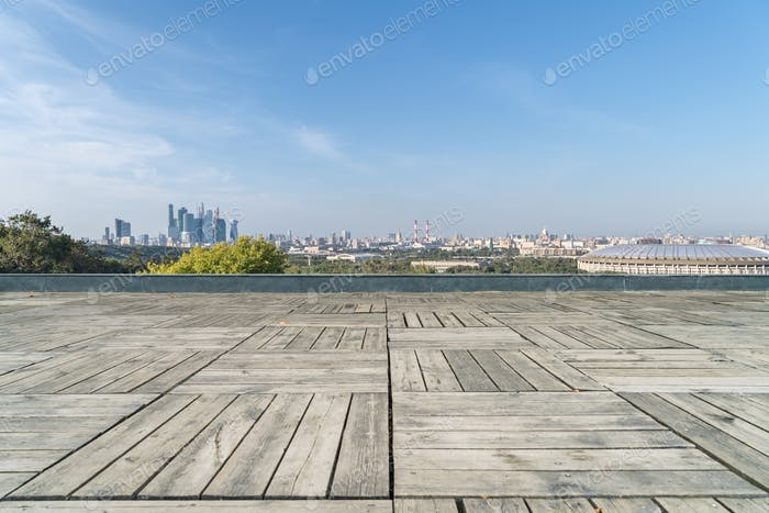 moscow city skyline and empty wooden floor , russia cityscape background