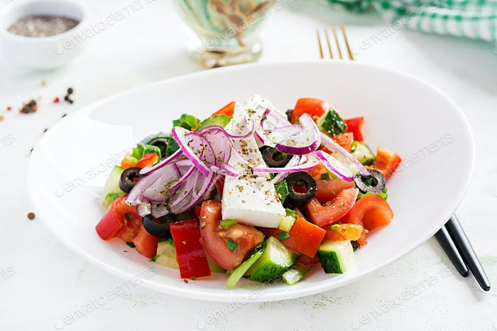 Trendy salad. Greek salad  with fresh vegetables, feta cheese and black olives.