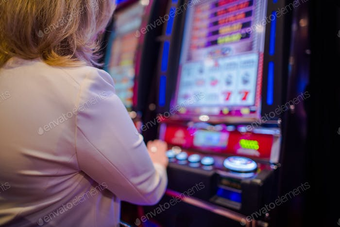 Woman Playing in the Casino