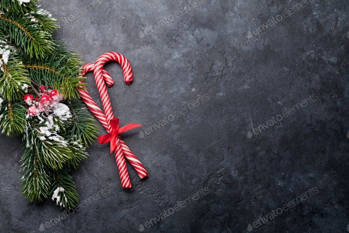 Christmas card with candy canes and fir tree