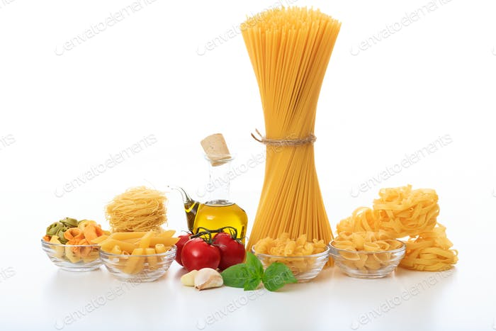 A bunch of raw spaghetti on a white background